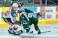 KELOWNA, CANADA - JANUARY 22: Colton Heffley #26 of the Kelowna Rockets checks Carson Stadnyk #16 of the Everett Silvertips during first period action on January 22, 2014 at Prospera Place in Kelowna, British Columbia, Canada.   (Photo by Marissa Baecker/Getty Images)  *** Local Caption *** Colton Heffley; Carson Stadnyk;