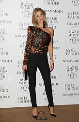 Rosie Huntington-Whiteley arrives at Claridge's Hotel in London to attend the Harper's Bazaar Women of the Year Awards.