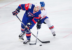 Blaz Gregorc of Slovenia vs Owen Fussey of Great Britain during ice-hockey match between Great Britain and Slovenia at IIHF World Championship DIV. I Group A Slovenia 2012, on April 15, 2012 in Arena Stozice, Ljubljana, Slovenia. (Photo by Vid Ponikvar / Sportida.com)