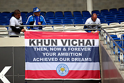 Leicester City fans with a flag of Thailand in memory of Vichai Srivaddhanaprabha which reads 'Khun Vichai then, now and forever your ambition achieved our dreams' before the match against Cardiff City at Cardiff City Stadium