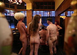 NOTE NUDITY (left to right) Jacob Bloomfield, Maria Beadell, pianist Luke Meredith, Davidos Pass and Emma Ruth taking part in London's first nudist pub singalong at the Coach And Horses in Soho.