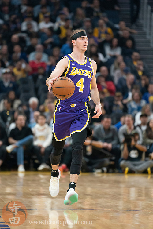 February 27, 2020; San Francisco, California, USA; Los Angeles Lakers guard Alex Caruso (4) dribbles the basketball during the second quarter against the Golden State Warriors at Chase Center.