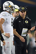 Oregon Ducks head coach Mark Helfrich has words with quarterback Marcus Mariota #8 against the Ohio State Buckeyes during the College Football Playoff National Championship Game at AT&T Stadium on January 12, 2015 in Arlington, Texas.  (Cooper Neill for The New York Times)