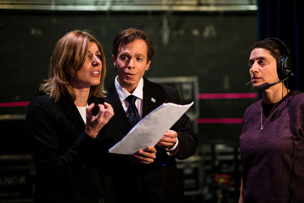 Israeli comic actors Roy Barnatan (C), who plays the role of Israeli Opposition Leader and leader of the Israeli Labor Party, Isaac Herzog and Shany Cohen (L), who plays the role of former Israeli Justice Minister Tzipi Livni are seen with Floor Manager Ruth Ron (R), as they rehearse their roles backstage prior to a filming of an episode of the top-rated Israeli satirical show 'Eretz Nehederet', Hebrew for 'Wonderful Country' at a television studio in Herzliya, Israel, on January 26, 2015.