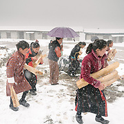 Parents are asked to give a wood donation to school in order to heat it up. Visiting the only school in Laya village.