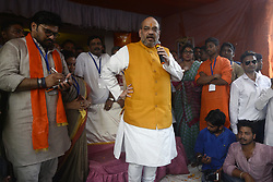 April 26, 2017 - Kolkata, West Bengal, India - BJP President, Amit Shah gives his speech to the people and his activist during his visit to Chetla Slum in Kolkata. National President of Bharatiya Janata Party, Amit Shah visited a slum at Chetla in Bhabanipur Constituency as a part of Booth Chalo Avijan during his three day visit to West Bengal as part of ''Vistaar Yatra'' expansion tour. (Credit Image: © Saikat Paul/Pacific Press via ZUMA Wire)
