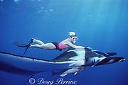 snorkeler and manta ray, Mobula birostris (formerly Manta birostris ), at The Boiler, San Benedicto, Revillagigedo National Park, Revillagigedos ( Socorro ) Islands, Mexico ( Eastern Pacific Ocean ) MR 196