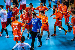 The Dutch handball player Bobby Schagen, Jeffrey Boomhouwer, Dani Baijens, Mark van den Beucken in action during the European Championship qualifying match against Turkey in the Topsport Center Almere.