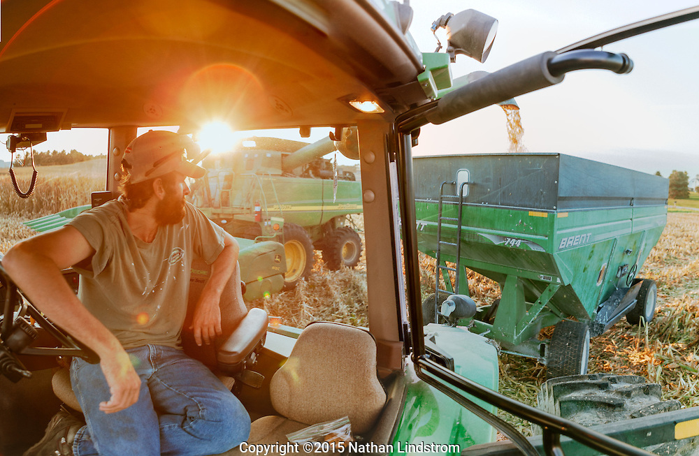 Farmer peering from tractor.<br /> Photographed by editorial lifestyle Texas photographer Nathan Lindstrom