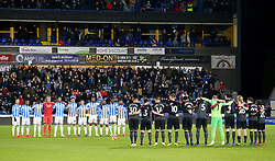 """Players line up to observe a minute's silence in honour of Emliano Sala during the Premier League match at the John Smith's Stadium, Huddersfield. PRESS ASSOCIATION Photo. Picture date: Tuesday January 29, 2019. See PA story SOCCER Huddersfield. Photo credit should read: Nigel French/PA Wire. RESTRICTIONS: EDITORIAL USE ONLY No use with unauthorised audio, video, data, fixture lists, club/league logos or """"live"""" services. Online in-match use limited to 120 images, no video emulation. No use in betting, games or single club/league/player publications"""
