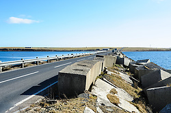 The Churchill Barriers are a series of four causeways in the Orkney Islands, Scotland, with a total length of 1.5 miles (2.3 km). They link the Orkney Mainland in the north to the island of South Ronaldsay via Burray and the two smaller islands of Lamb Holm and Glimps Holm.<br /> <br /> The barriers were built in the 1940s bt Italian prisoners of war primarily as naval defences to protect the anchorage at Scapa Flow, but now serve as road links, carrying the A961 road from Kirkwall to Burwick.<br /> <br /> (c) Andrew Wilson | Edinburgh Elite media