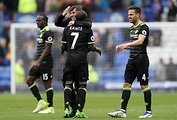 Chelsea's N'Golo Kante celebrates with manager Antonio Conte after the final whistle