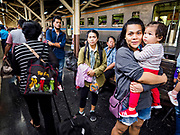 02 JANUARY 2019 - BANGKOK, THAILAND:      People wait for the train going to Trang to come into Hua Lamphong Train Station in Bangkok. The train and bus stations in Bangkok were crowded Wednesday with people going home after the long New Year's weekend.     PHOTO BY JACK KURTZ