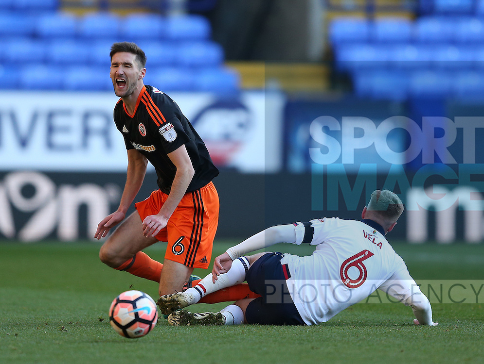 Chris Basham of Sheffield Utd fouled by Josh Vela of Bolton during the FA Cup Second round match at the Macron Stadium, Bolton. Picture date: December 4th, 2016. Pic Simon Bellis/Sportimage