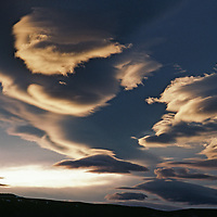 Lenticular clouds called the Sierra Wave hover over the eastern Sierra Nevada.