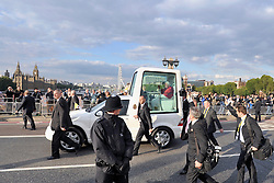 CENTRAL LONDON. Pope Benedict XVI travels across The River Thames on Lambeth Bridge in the Popemobile. Crowds line the streets as Pope Benedict XVI makes the 10 minute journey from Lambeth Palace the London residence of the Anglican Archbishop of Canterbury, Rowan Douglas Williams, to Westminster Abbey. 17th September 2010.STEPHEN SIMPSON