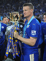 Football - 2015 / 2016 Premier League - Leicester City vs. Everton<br /> <br /> Robert Huth of Leicester with the trophy at the King Power Stadium.<br /> <br /> COLORSPORT/ANDREW COWIE