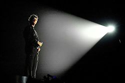 """Brian McFadden in the spotlight during when Westlife play their third consecutive concert at the Hallam FM Arena at the start of their """"Unbreakable"""" Tour 2003 Monday 21st July 2003<br /> <br /> Image Copyright Paul David Drabble<br /> 21 July 2003"""