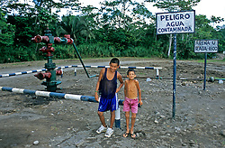 Local brothers in Lago Agrio, Ecuador affected by the oil contamination. The older brother guides the younger brother who has gone blind from the effects of the oil contamination of the water