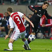 NLD/Amsterdam/20100928 - Champions Leaguewedstrijd Ajax - AC Milan, Zlatan Ibrahimovic in duel met Toby Alderweireld