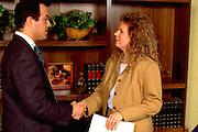 Business associates age 32 and age 33 shaking hands.  St Paul Minnesota USA