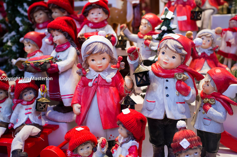 Detail of traditional wooden carved figures on  craft stall shop at Cologne Christmas Market  in Germany