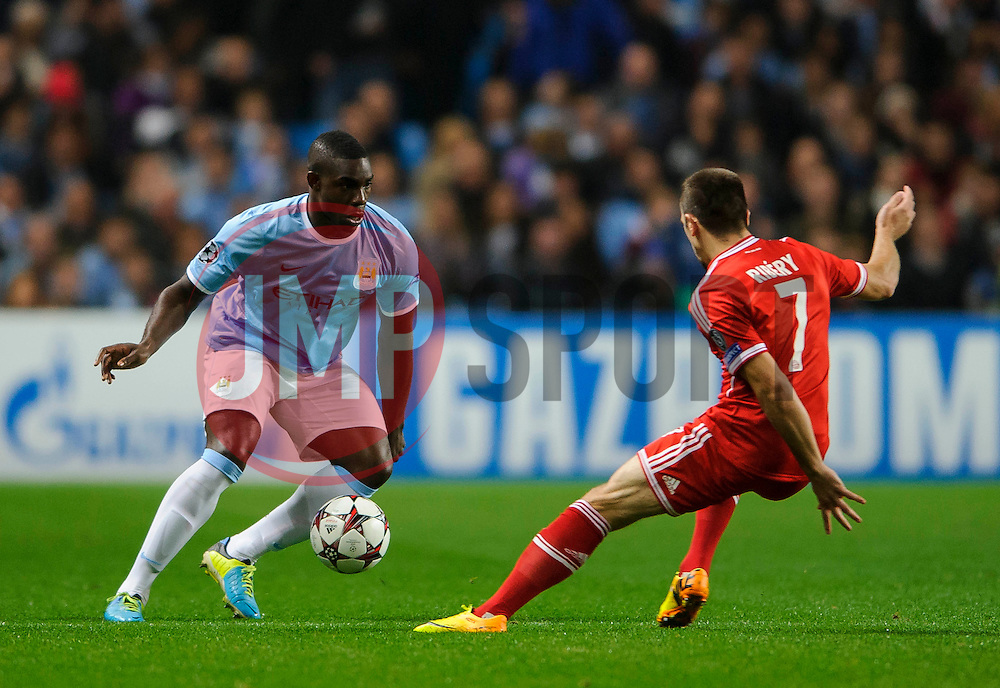 Man City Defender Micah Richards (ENG) is challenged by Bayern Midfielder Franck Ribery (FRA) during the first half of the match - Photo mandatory by-line: Rogan Thomson/JMP - Tel: Mobile: 07966 386802 - 02/10/2013 - SPORT - FOOTBALL - Etihad Stadium, Manchester - Manchester City v Bayern Munich - UEFA Champions League Group D.