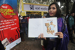 February 5, 2018 - Dhaka, Bangladesh - A girl showing Cricketer Shakib Al Hasan written a book name is ''Halum'' after buy in Ekushey Book Fair in Dhaka, Bangladesh. On February 5, 2018. (Credit Image: © Str/NurPhoto via ZUMA Press)