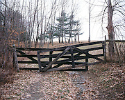 wooden gate in rural landscape.
