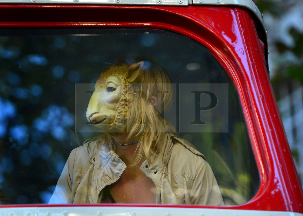 © Licensed to London News Pictures. 12/10/2012. Westminster, UK A woman sheeps mask on a bus outside the DEFRA (Department for Environment, Food and Rural Affairs) building.  A Rally on live animal transport held by Compassion in World Farming (CIWF) and RSPCA outside DEFRA today 12 October 2012. The groups handed in a petition and report urging ministers not to issue any more licences for live transport until legislation on journey times and port facilities is enforced. Photo credit : Stephen Simpson/LNP