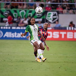 Nigeria's FRANSISCA ORDEGA (17) and USA's CRYSTAL DUNN (19) clash as the US Women's National Team (USWNT) beats Nigeria, 2-0 in the inaugural match of Austin's new Q2 Stadium. The U.S. women's team, an Olympic favorite, is wrapping up a series of summer matches to prep for the Tokyo Games.