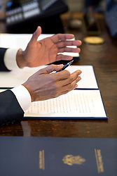 President Barack Obama gestures prior to signing a Memorandum of Disapproval regarding S.J. Res. 8, a Joint Resolution providing for congressional disapproval of the rule submitted by the National Labor Relations Board relating to representation case procedures, in the Oval Office, March 31, 2015. (Official White House Photo by Pete Souza)<br /> <br /> This official White House photograph is being made available only for publication by news organizations and/or for personal use printing by the subject(s) of the photograph. The photograph may not be manipulated in any way and may not be used in commercial or political materials, advertisements, emails, products, promotions that in any way suggests approval or endorsement of the President, the First Family, or the White House.
