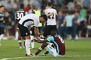 Fabrício Dornellas of Astra Giurgiu consoles Cheikhou Kouyate of West Ham United after the final whistle. UEFA Europa league, 1st play off round match, 2nd leg, West Ham Utd v Astra Giurgiu at the London Stadium, Queen Elizabeth Olympic Park in London on Thursday 25th August 2016.<br /> pic by John Patrick Fletcher, Andrew Orchard sports photography.