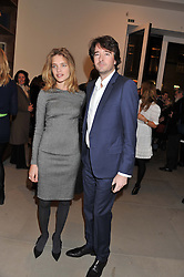 NATALIA VODIANOVA and ANTOINE ARNAULT at a private view of work by Mat Collishaw - 'This is Not an Exit' held at Blaine/Southern, 4 Hanover Square, London on 13th February 2013.