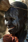 Old Woman with face painted, Mursi Tribe, Mago National Park, Lower Omo Valley, Ethiopia, portrait, person, one, tribes, tribal, indigenous, peoples, Southern, ethnic, rural, local, traditional, culture, primitive, smiling, laughing