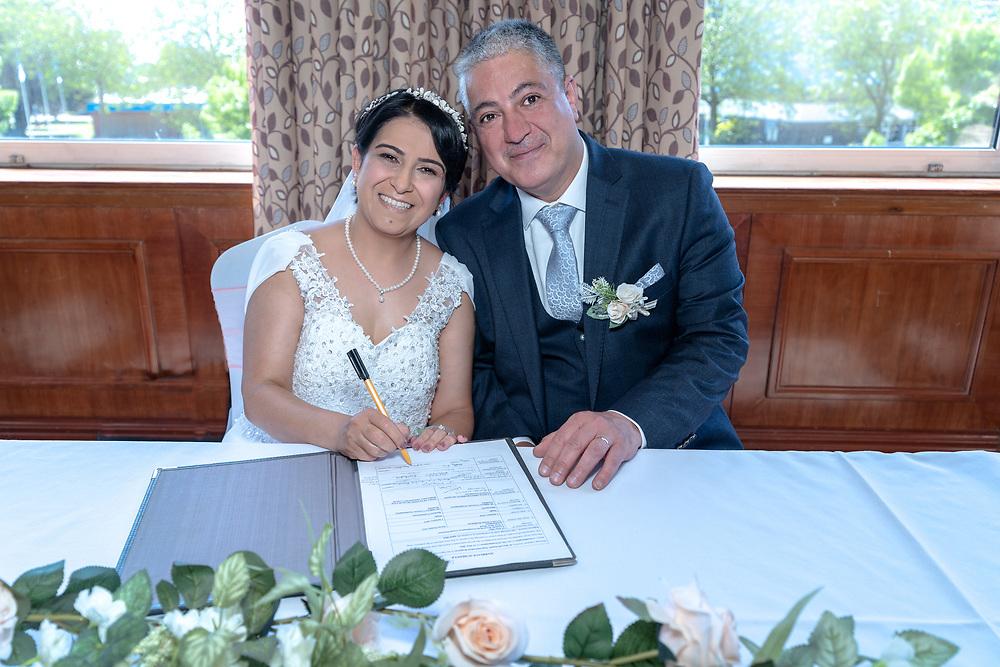 Bride signing the wedding register at Leonardo Royal Southampton Grand Harbour