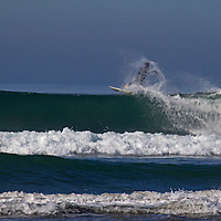 USA, California, San Diego. Surfer cutting out of wave at Cardiff by the Sea.