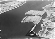 "Ackroyd 07312-5. Shaver Transportation. Aerials. Log storage upstream from Texaco dock. December 6, 1956"" (DEQ Site ID 1155. Gunderson Area 3, 5x7"")"