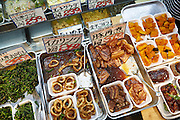 Food for sale at Kuromon Ichiba Market. The market is known as Osaka's Kitchen, and offers a large variety of fresh and cooked food.