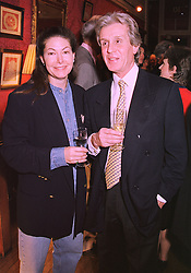 Jeweller SANDRA CRONAN and her husband MR BARRY CRONAN at a party in London on 5th February 1998.MFE 8