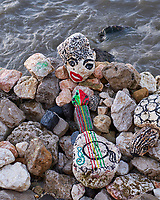 Stone Art along the Tagus River in Lisbon. Image taken with a Fuji X-T3 camera and 35 mm f/1.4 lens.
