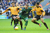 Photo: Dave Linney.<br />Wolverhampton Wanderers v Norwich City. Coca Cola Championship. 05/11/2005. Dean Ashton in the thick of the cation with Leon Clarke/Left &Joleon Lescott/right.