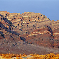 Arid, eroded Last Chance Mountains rise above Eureka Valley in California's Death Valley National Park.