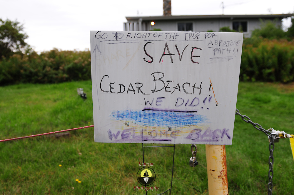Harpswell, Maine -- 9/16/14 -- A signs celebrates the recent legal approval of the easement allowing public access to Cedar Beach via the Aspatore Path. Photo by Roger S. Duncan for The Forecaster.