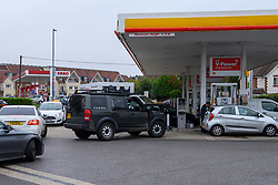 © Licensed to London News Pictures. 25/09/2021. High Wycombe, UK. Cars queue up at a Shell petrol station on Penn Road in Hazelmere as panic buying takes hold following reports of fuel shortages due to delivery difficulties in the supply chain across in the UK because of a lack of HGV drivers. Photo credit: Peter Manning/LNP