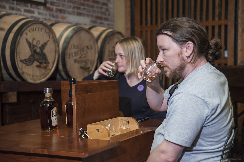Emily Hesselbein, left, and Dan Herbert, both of Colombus, Ohio, taste Elijah Craig 12-year-old super-premium bourbon whiskey on a tour of the Evan Williams Bourbon Experience, photographed Friday, April 11, 2014 in downtown Louisville, Ky. (Photo by Brian Bohannon)