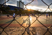 """Over a concrete finished floor, Paulistas play a variation of outdoor  """"Futsal"""", which originally was played in doors on wooden floors, Sao Paulo city"""
