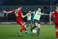 Anthony Hartigan of Wimbledon and Ben Barclay of Accrington  contest a loose ball  during the EFL Sky Bet League 1 match between Accrington Stanley and AFC Wimbledon at the Fraser Eagle Stadium, Accrington, England on 1 February 2020.