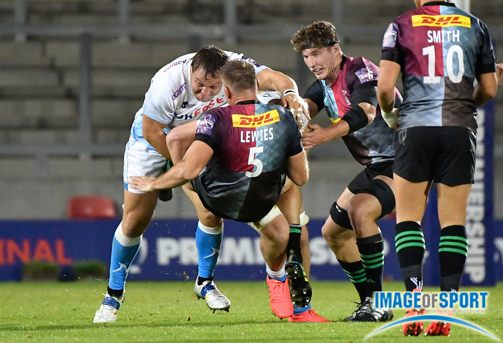 Sale Sharks flanker Jono Ross and prop Coenie Oosthuizen put in a big hit on Harlequins lock Stephan Lewis  during The Premiership Rugby Cup Final at The AJ Bell Stadium, Eccles, Greater Manchester, United Kingdom, Monday, September 21, 2020. (Steve Flynn/Image of Sport)