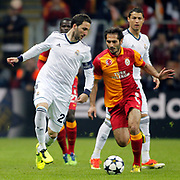 Galatasaray's Hamit Altintop (R) and Real Madrid's Gonzalo Higuain (L) during their UEFA Champions League Quarter-finals, Second leg match Galatasaray between Real Madrid at the TT Arena AliSamiYen Spor Kompleksi in Istanbul, Turkey on Tuesday 09 April 2013. Photo by Aykut AKICI/TURKPIX